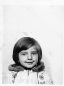 black and white photobooth photo of me when I was three years old.