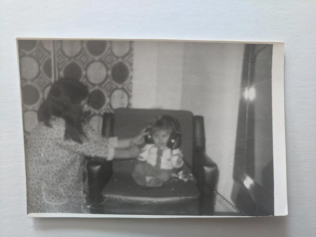 mom and me in 1978, black and white photo, she's holding headphones on my head